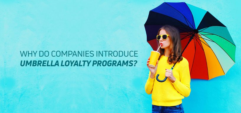 Why do companies introduce umbrella loyalty programs?