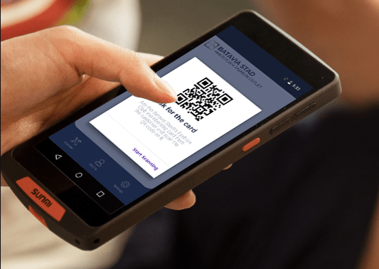 A scanner device and a mobile held in hands, showing how a loyalty transaction works during checkout